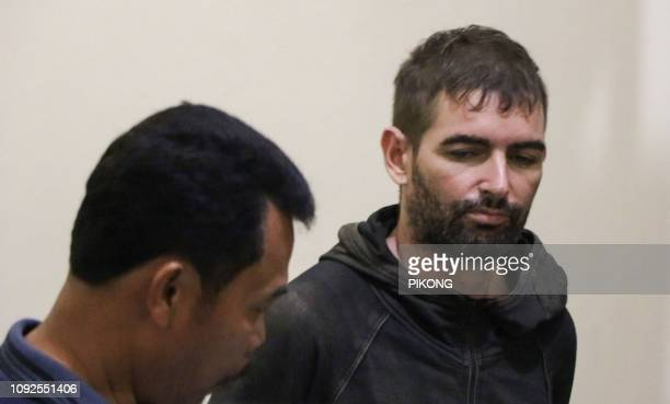 Frenchman Felix Dorfin is under escort after escaping from jail in Mataram on the holiday island of Lombok on February 2 helped by a police officer...