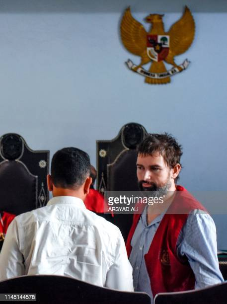 Frenchman Felix Dorfin turns to his his translator after he was sentenced to death by a court in Mataram on the resort island of Lombok on May 20...
