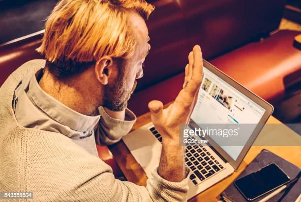 Frenchman gazing at his computer screen.