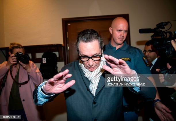 Frenchman JeanClaude Arnault reacts as he arrives at the district court in Stockholm on September 19 where he is to appear accused of rape and sexual...