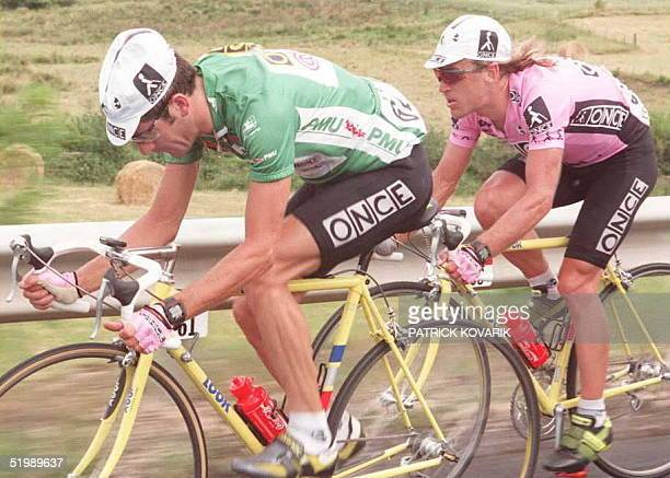 Frenchman Laurent Jalabert wearing the green jersey of the best sprinter and his teammate Neil Stephens ride wheel into wheel during the 12th stage...