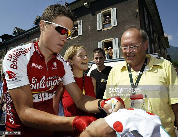 Frenchman Sylvain Chavanel signs autographs to fans before the eighth stage of the 90th Tour de France cycling race between Sallanches and l'Alpe...