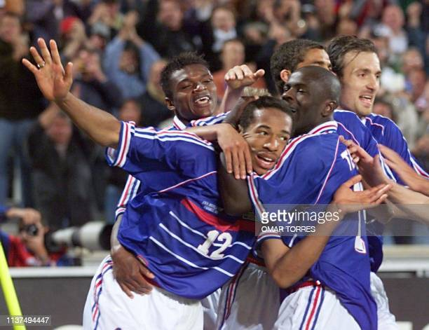 Frenchman Thierry Henry is congratulated by his teammates Marcel Desailly Lilian Thuram David Trezeguet and Christophe Dugarry after scoring the...