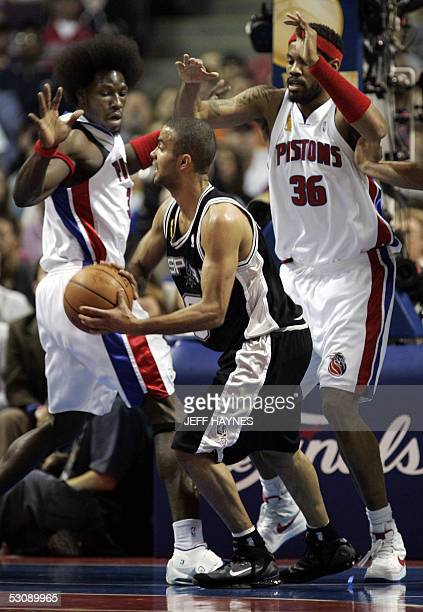 3fada5ff0 Frenchman Tony Parker of the San Antonio Spurs is guarded by Rasheed  Wallace and Ben Wallace