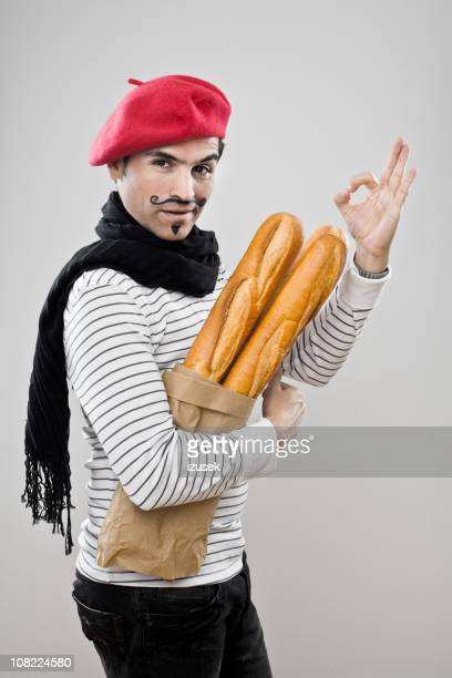 frenchman with french baguettes - franse cultuur stockfoto's en -beelden