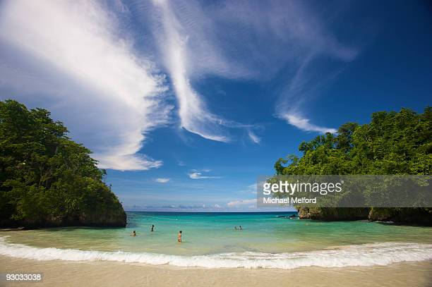 People enjoying a swim at Frenchman's Cove in Jamaica.