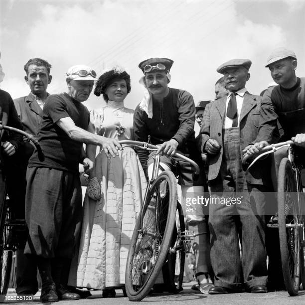 Frenchmen Maurice Garin winner of the first Tour de France in 1903 and Eugene Christophe who wore the first leader's yellow jersey in 1919 pose next...