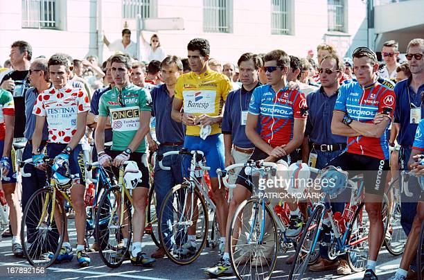 Frenchmen Richard Virenque and Laurent Jalabert Spaniard Miguel Indurain and US teammates Frankie Andreu and Lance Armstrong stand still while...