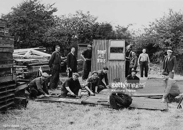 Frenchmen Working To Dismantle Army Huts For Shipment To France In England On August 1945