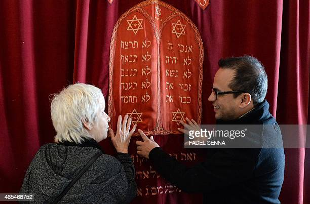 French-Moroccan Kamal Hachkar, who directed a documentary about the Jews of Morocco talks with Fanny Mergui, a Moroccan Jewish woman at Casablanca's...