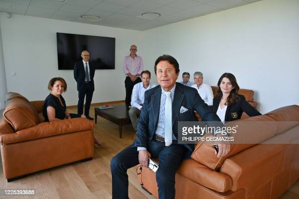 FrenchPolish millionaire businessman FC Nantes' president and Vivacy CEO Waldemar Kita poses with staff members at the company's headquarters in...