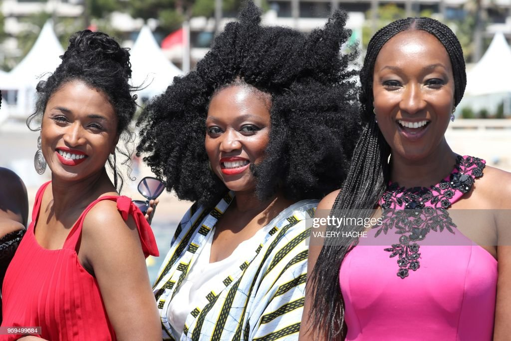 French-Portuguese actress Sara Martins, French actress Sabine Pakora and French actress Nadege Beausson-Diagne, members of a group of 16 black women who fight for equality and inclusion of black women in the French film industry, pose on May 17, 2018 during a photocall for the book 'My Profession is Not Back' on the sidelines of the 71st edition of the Cannes Film Festival in Cannes, southern France.
