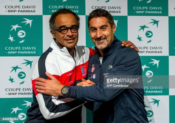 French's captain Yannick Noah and Serbia's captain Nenad Zimonjic pose during a press conference ahead of the Davis Cup World Group semifinal between...