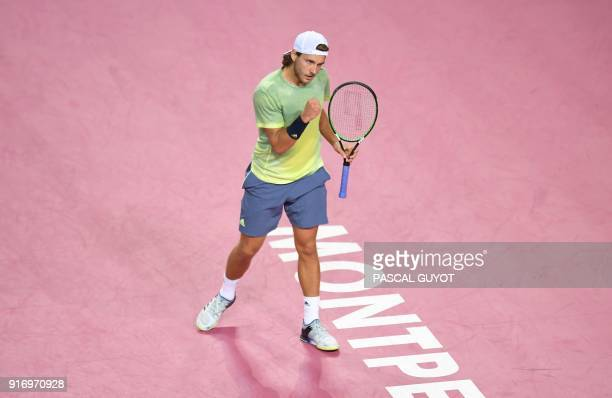 French's Lucas Pouille reacts after winning a point against France's Richard Gasquet during their the ATP World Tour Open Sud de France final tennis...