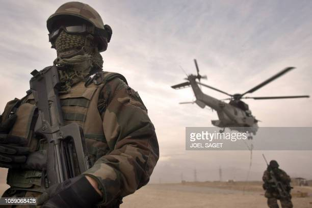 Frenchs paratroopers of the 3 RPIM stand alert as Caracal helicopters from the EH1/67 unit hover over Forward Operating Base Tora on December 15 2008...