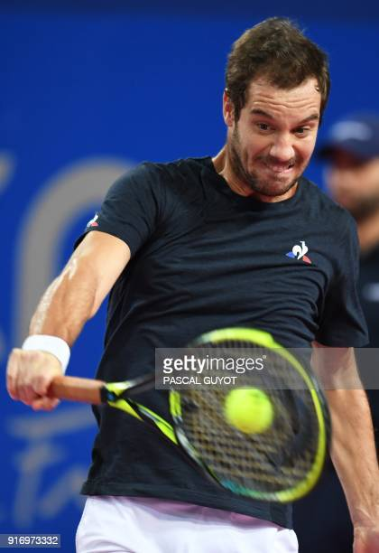 French's Richard Gasquet returns the ball to France's Lucas Pouille in the final of the ATP World Tour Open Sud de France in Montpellier southern...