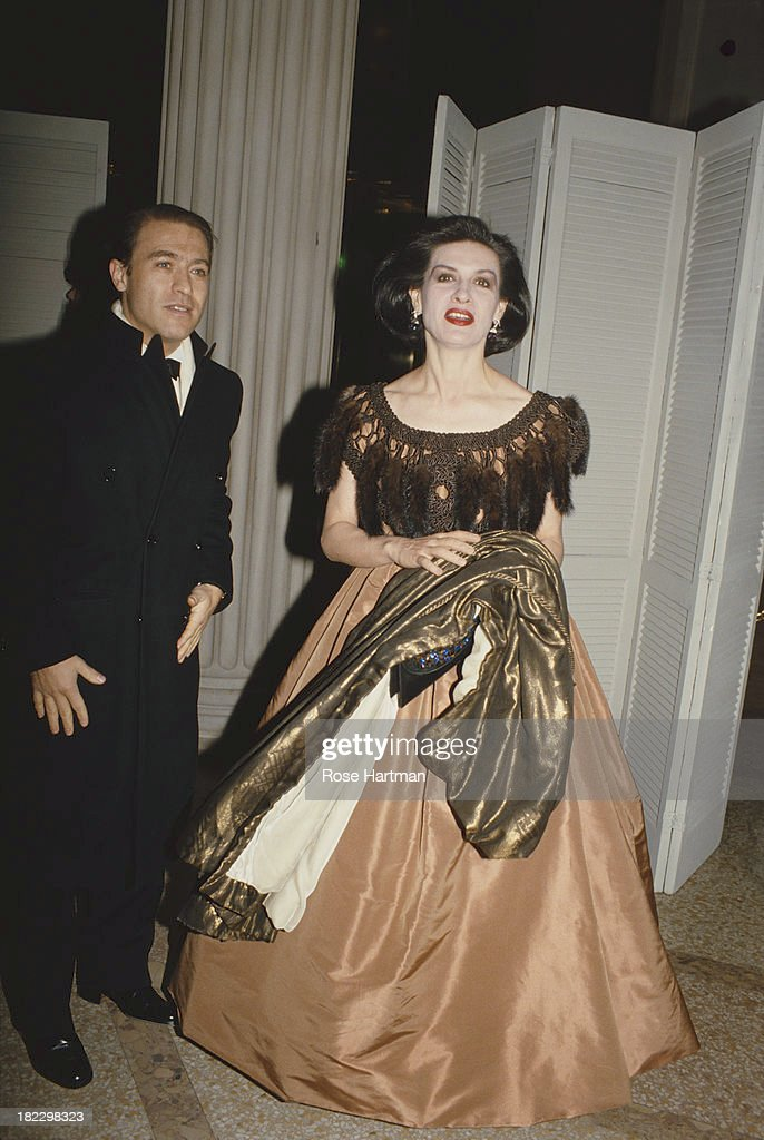 French/Spanish fashion designer and businesswoman Paloma Picasso wearing a Christian Lacroix dress with Rafael Sanchez at the Metropolitan Museum of Art Gala, New York City, circa 1993.