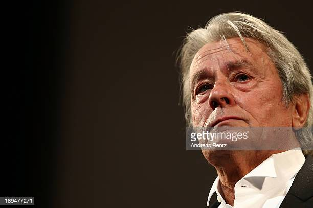 French-Swiss actor Alain Delon appears on stage during a Tribute To Alain Delon at Theatre Lumiere during The 66th Annual Cannes Film Festival at the...