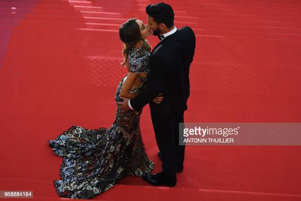 FrenchSwiss model Nabilla Benattia and her partner Thomas Vergara kiss as they arrive on May 15 2018 for the screening of the film Solo A Star Wars...