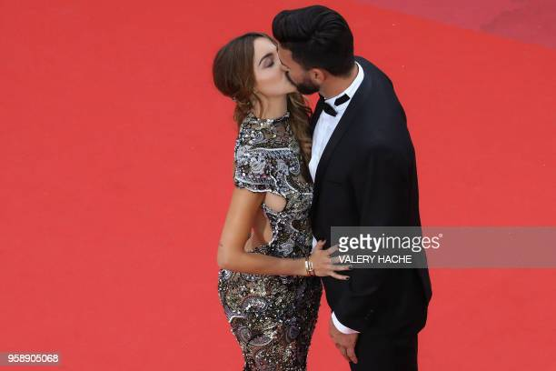 FrenchSwiss model Nabilla Benattia and her partner Thomas Vergara kiss as they arrive on May 15 2018 for the screening of the film 'Solo A Star Wars...