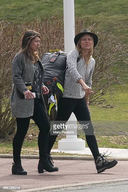 FrenchSwiss snowboarder AnneFlore Marxer leaves the Honours Pavilion at CharlesdeGaulle airport on March 14 2015 French sports stars and crew from...