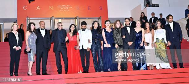 FrenchTunisian director Abdellatif Kechiche and cast members arrive for the screening of the film 'Mektoub My Love Intermezzo' during the 72nd annual...