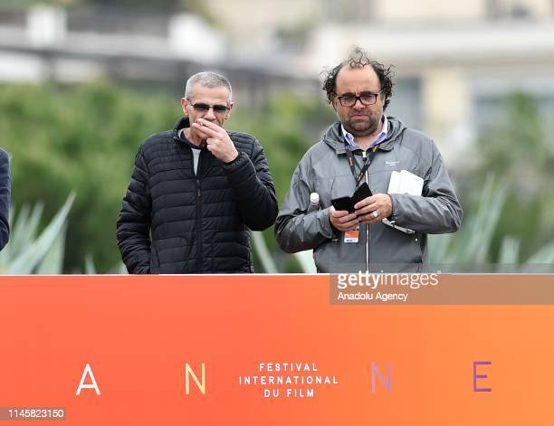 FrenchTunisian director Abdellatif Kechiche observes US actor Sylvester Stallone after press conference during the 72nd annual Cannes Film Festival...