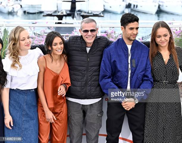 FrenchTunisian director Abdellatif Kechiche poses with cast members during the photocall for the film 'Mektoub My Love Intermezzo' at the 72nd annual...