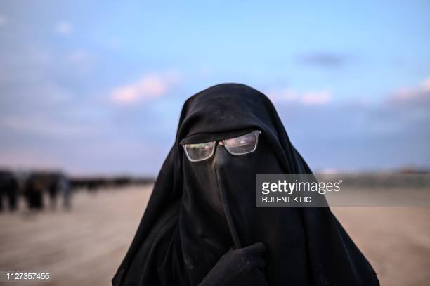 French-Tunisian Umm Yussef speaks to AFP during an interview, as she walks towards the Kurdish-led Syrian Democratic Forces after leaving the IS...