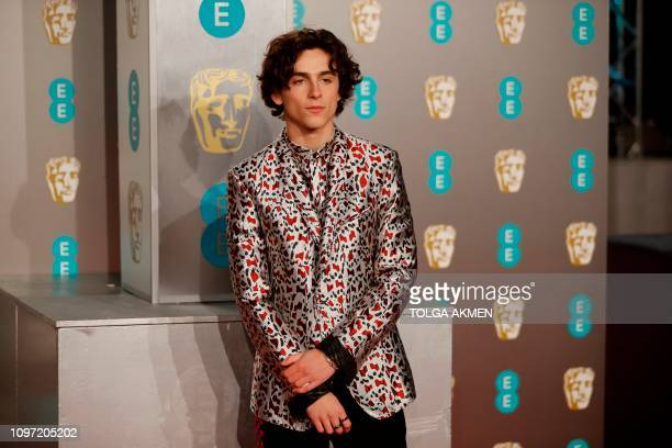 FrenchUS actor Timothee Chalamet poses on the red carpet upon arrival at the BAFTA British Academy Film Awards at the Royal Albert Hall in London on...