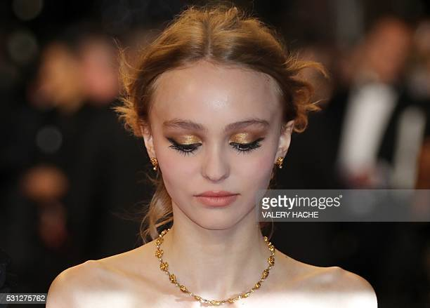 TOPSHOT FrenchUS actress LilyRose Depp poses as she arrives on May 13 2016 for the screening of the film La Danseuse at the 69th Cannes Film Festival...