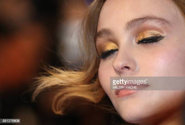 FrenchUS actress LilyRose Depp poses as she arrives on May 13 2016 for the screening of the film La Danseuse at the 69th Cannes Film Festival in...