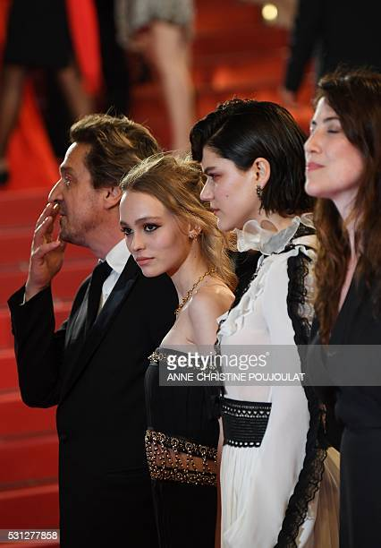 FrenchUS actress LilyRose Depp poses on May 13 2016 as she arrives for the screening of the film La Danseuse at the 69th Cannes Film Festival in...