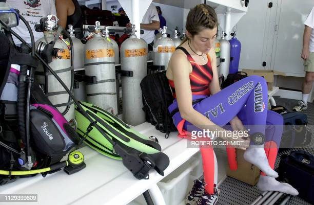 Frenchwoman Audrey Mestre Ferreras adjusts a diving watch to her ankle as she prepares to join her husband Pipin Ferreras to set the first record in...