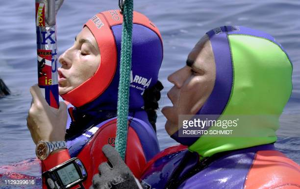 Frenchwoman Audrey Mestre Ferreras and her husband Pipin Ferreras take a last breath before diving and setting the first record in the mixed tandem...