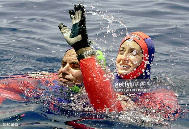 Frenchwoman Audrey Mestre Ferreras and her husband Pipin Ferreras celebrates after setting the first record in the mixed tandem free dive no limits...