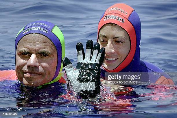 Frenchwoman Audrey Mestre Ferreras and her husband Pipin Ferreras celebrate after setting the first record in the mixed tandem free dive no limits...