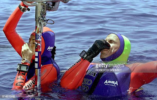 Frenchwoman Audrey Mestre Ferreras and her husband Pipin Ferreras dive to set the first record in the mixed tandem free dive no limits category, 103...