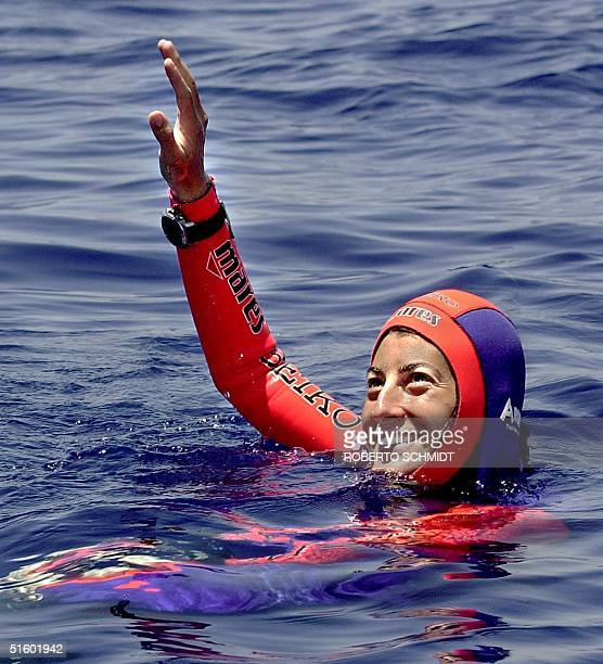 Frenchwoman Audrey Mestre Ferreras waves after she and her husband Pipin Ferreras established the first record in the mixed tandem free dive no...