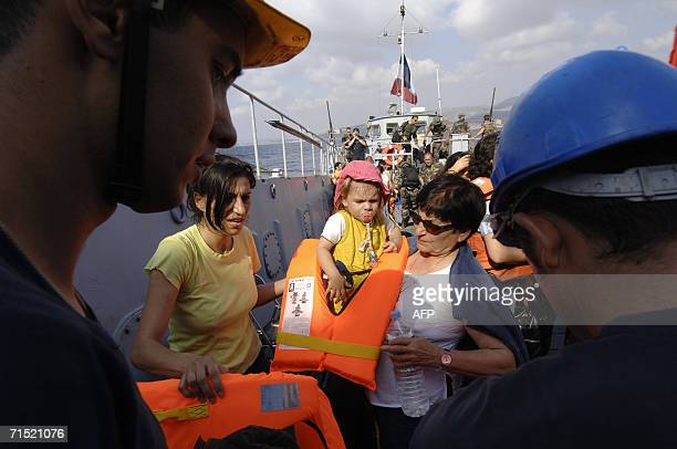 Frenchwoman Ghada Lenoir with her 20monthold daughter Eliana and her mother Milia Ajaka are evacuated by the French navy aboard the amphibious...