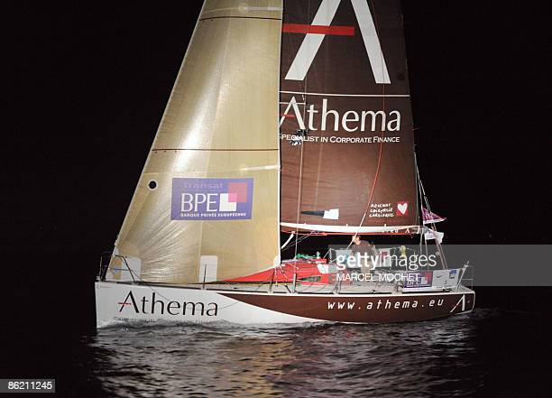 "Frenck Erwan Tabarly, skipper of monohull ""Athema"" crosses the finish line on April 25, 2009 upon his arrival at Grand-Bourg harbour on Marie-Galante..."