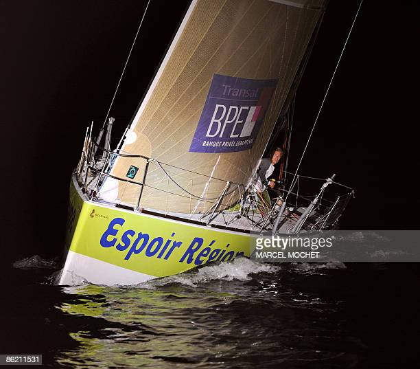 Frenck François Gabart skipper of monohull Espoir Région Bretagne crosses the finish line on April 25 2009 upon his arrival at SaintLouis harbour...