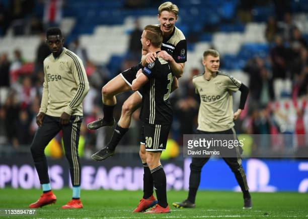 Frenkie de Jong and Dani de Wit of Ajax celebrate victory after the UEFA Champions League Round of 16 Second Leg match between Real Madrid and Ajax...