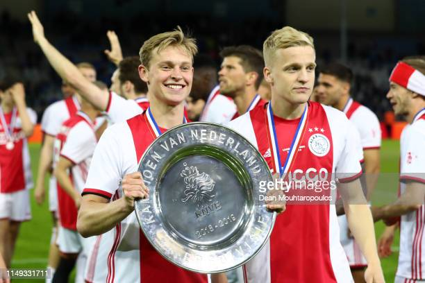 Frenkie de Jong of Ajax and Donny van de Beek of Ajax celebrate with the trophy after winning the Eredivisie following the Eredivisie match between...