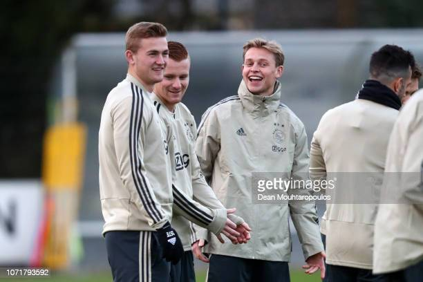 Frenkie de Jong of Ajax and Matthijs de Ligt of Ajax share a joke during a training session ahead of their UEFA Champions League Group E match...