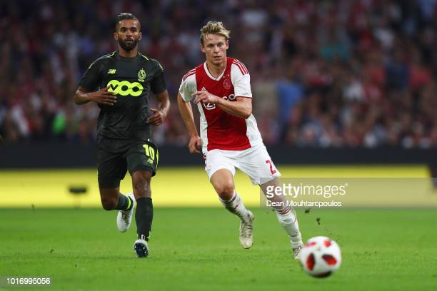 Frenkie de Jong of Ajax battles for the ball with Mehdi CarcelaGonzalez of Standard de Liege during the UEFA Champions League third round qualifying...