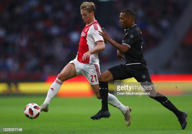Frenkie de Jong of Ajax battles for the ball with Michael Chacon of FC Emmen VV during the Eredivisie match between Ajax and Emmen at Johan Cruyff...