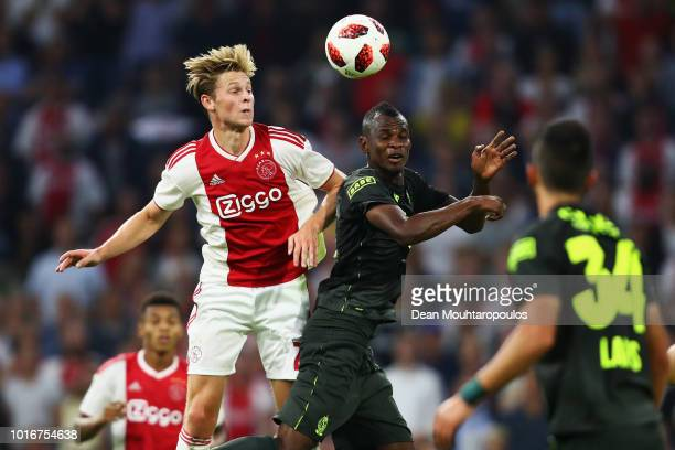 Frenkie de Jong of Ajax battles for the ball with Uche Agbo of Standard de Liege during the UEFA Champions League third round qualifying match...