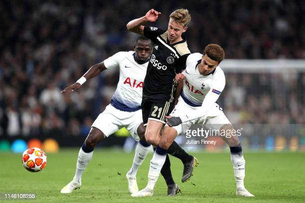 Frenkie de Jong of Ajax battles with Dele Alli and Moussa Sissoko of Tottenham Hotspur during the UEFA Champions League Semi Final first leg match...