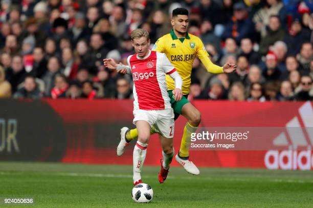 Frenkie de Jong of Ajax Bjorn Johnsen of ADO Den Haag during the Dutch Eredivisie match between Ajax v ADO Den Haag at the Johan Cruijff Arena on...